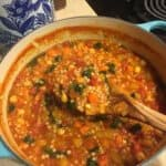 Moroccan Butternut, Chickpea, and Couscous Stew made in a light blue Le Creuset dutch oven.